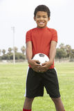 Young Boy In Football Team. Young African American Boy In Football Team royalty free stock photo