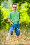 Young boy in a forest Royalty Free Stock Image