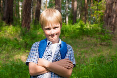 Young boy in forest Stock Images