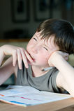 Young boy with freckle. At homework or school thinking Royalty Free Stock Photos