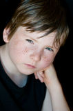 Young boy with freckle. In portrait on dark background Stock Images
