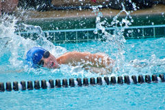 Young Boy /Freestyle in Pool. A young boy swimming freestyle in a competition. 10 years old stock photo