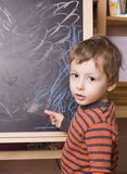 Young Boy in front of the blackboard Royalty Free Stock Photos