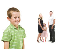 Young boy in front of his family Stock Images