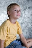 Young boy in front of photo ba Royalty Free Stock Photography