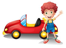 A young boy in front of a red car Royalty Free Stock Photography
