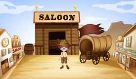 A young boy in front of a saloon bar Royalty Free Stock Photos