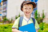 Young boy in front of school Stock Photos