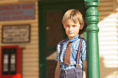 Young Boy in front of shop Stock Image
