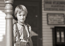 young Boy in front of shop Stock Photos