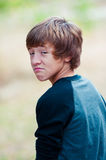 Young teen looking at camera with frown face Stock Photography