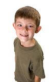 Young Boy, Funny Smile. Young boy portrait perspective from above him with a funny smile isolated on white Stock Photos