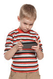 Young boy with a gadget Royalty Free Stock Photos