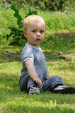 Young boy in garden Stock Photo