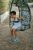 Young boy on garden swing Royalty Free Stock Image