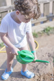 Young boy gardener watering Royalty Free Stock Images