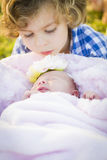 Young Boy Gazing at His Newborn Baby Girl Sister Royalty Free Stock Photography