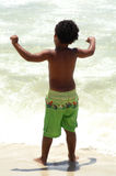 Young Boy Gazing Out At The Ocean Stock Photo