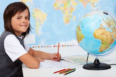 Young boy in geography class Royalty Free Stock Photography