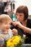 Young boy getting haircut from styist Stock Photography