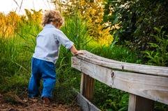 Boy Getting Off a Bridge royalty free stock photography