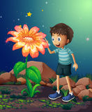 A young boy beside the giant flower Royalty Free Stock Image