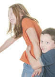 Young boy and girl being physical. Young girl and boy playing tickle game Stock Photo