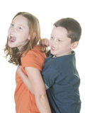 Young boy and girl being physical. Young boy and girl in fight Royalty Free Stock Photography