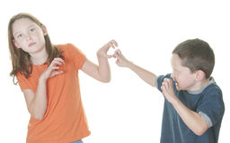 Young boy and girl fighting. Young boy and girl being physical Stock Image