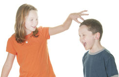 Young boy and girl fighting. Young boy and girl being physical Stock Images