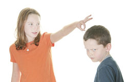 Young boy and girl fighting. Young boy and girl being physical Royalty Free Stock Photo