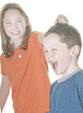 Young boy and girl fighting. Young boy and girl being physical Royalty Free Stock Photography