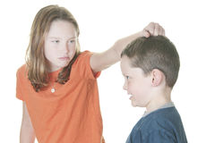 Young boy and girl fighting. Young boy and girl being physical Stock Photo
