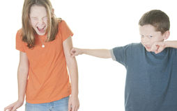 Young boy and girl fighting Royalty Free Stock Photo