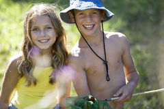A young boy and girl with a fishing net Royalty Free Stock Photo