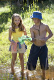 A young boy and girl with fishing nets Royalty Free Stock Image