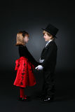 Young boy and girl in formal clothes Royalty Free Stock Photography