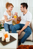 Young boy and girl with a glass of orange juice. Young boy and a beauty, young girl with a glass of orange juice Stock Images
