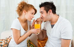 Young boy and girl with a glass of orange juice. Young boy and a beauty, young girl with a glass of orange juice Royalty Free Stock Photography