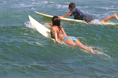 Young boy and girl go surfing in Hawaii Stock Photo