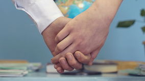 Young boy and girl holding hands. On the background of the world globe stock video