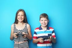 Boy and girl with joysticks royalty free stock photo