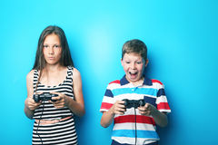 Boy and girl with joysticks Royalty Free Stock Photography