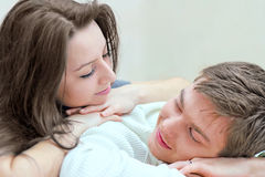 Young guy and girl look at each other Stock Images