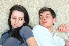 Young guy and girl look at each other Royalty Free Stock Photo