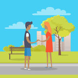 Young Boy and Girl in Love Stand on Park Path Stock Photo