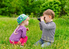 Young boy and girl playing with binoculars Stock Photography