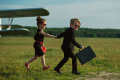 Young boy and girl playing spy. Photo of young boy and girl playing spy Royalty Free Stock Photos