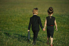Young boy and girl playing spy Stock Photo