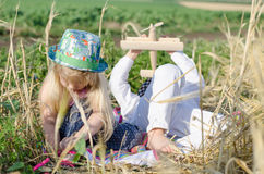Young boy and girl playing in a wheat field Stock Image